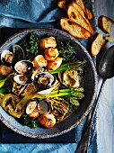 Barigoule of artichokes, asparagus and kale with scallops and clams