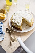 Lemon and coconut cake, partly sliced