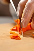 Carrots being sliced