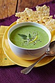 A Bowl of Spring Pea Soup with Cheese Crisps