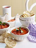 Tomato and lentil soup with coriander and poppadoms