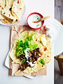 Pork souvlaki on flatbread with a yoghurt sauce