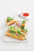 Baguette sandwiches with roast pork, julienne vegetables and coriander