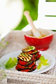 Vegetable stacks of grilled aubergine slices and tomatoes