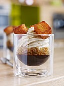 A dessert of coffee granita with chocolate sauce and sweetened cream topping
