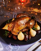 Roast guinea fowl with pears and dates