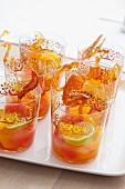 Fruit punch with sticks of caramel