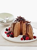 Ice cream bombe with chocolate sauce and fresh berries