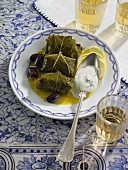 Stuffed vine leaves with black olives