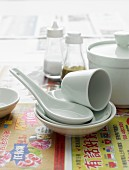 A variety of japanese crockery on japanese newspaper