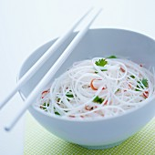 Glass noodles with chilli and coriander in a white bowl
