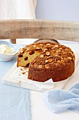 Date cake with sliced almonds and crumble
