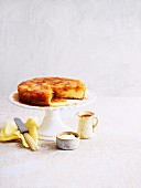 Apple upside-down cake on a cake stand