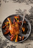 Roasted duck leg with apples and onions