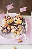 Berry muffins decorated with rolled oats and flags