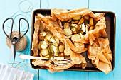 Kartoffeln mit Camembert, im Pergament gebacken
