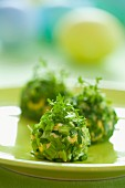 Balls of creamed egg coated in chives