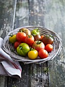 Various types of tomatoes in a wicker basket