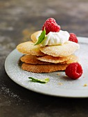 Langues de chat with whipped cream and raspberries