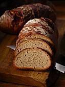 Farmhouse bread, partly sliced