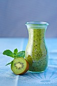 Kiwi smoothie in a small glass carafe