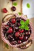 A Basket of Fresh Cherries with Mint