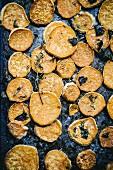 Baked sweet potato slices on a baking tray