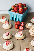 Strawberry biscuits with strips of glacé icing