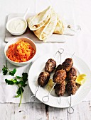 Spicy lamb koftas with carrot salad, houmous and flatbread