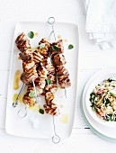Grilled skewers of pork collar with oregano and orzo salad