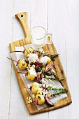 Grilled potato skewers with bacon and rosemary