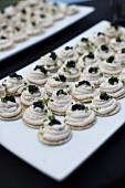 Crackers Topped with Smoked Trout Mousse and Caviar