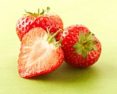 Two whole and one half strawberry