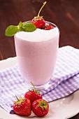 A milkshake with fresh strawberries