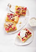 Mirabelle and redcurrant cake, cut into portions