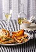 Stuffed chicken breast with potato wedges