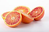 Five blood orange halves