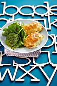 Filled pastry parcels with spinach salad