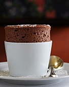 Chocolate soufflé dusted with icing sugar