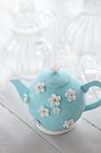 Teapot cake with sugar flowers