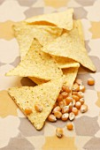 Tortilla chips and corn kernels