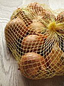 Brown onions in net