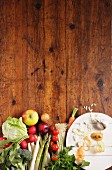 Vegetables and fruit on a wooden slab
