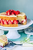 Strawberry Fraisier cake slice removed