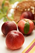 Nectarines in front of a basket