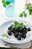 Fresh blackberries with a muslin cloth on a plate