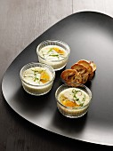 Oeufs en cocotte (baked eggs, France) with chervil and toasted slices of bread