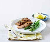 Salmon with a mustard & tomato crust and asparagus