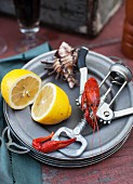 Crawfish on a Plate with a Corkscrew and Lemon