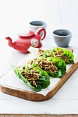 San choy bow (minced meat in a lettuce leaf, China)